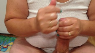 Cock play and titty fucking results in a messy cum shot on wife's big tits